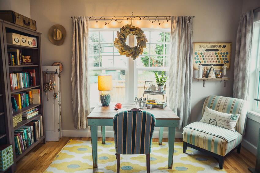 beige-table-lamp-on-table-with-chair-in-room