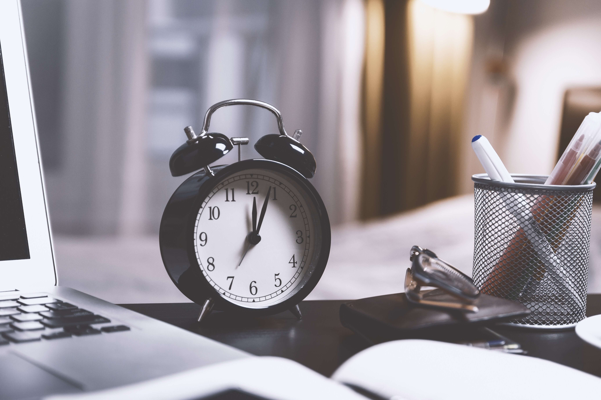 black-twin-bell-alarm-desk-clock-on-table