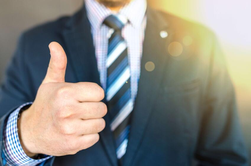 close-up-photo-of-man-wearing-black-suit-jacket-doing-thumbs-up