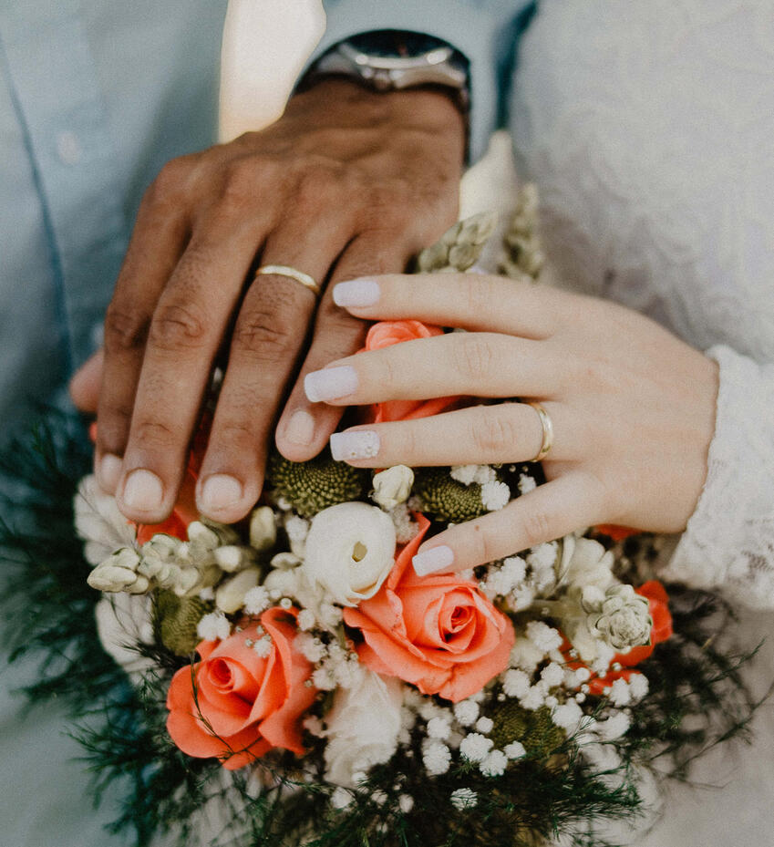 man-and-woman-s-hands-on-top-of-ball-bouquet