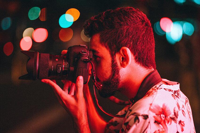 man-holding-dslr-camera