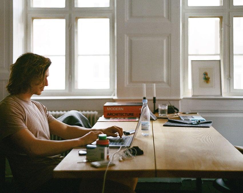man-sitting-while-using-laptop-1