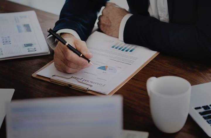 man-writing-financial-plan