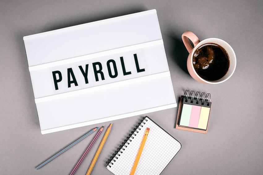 payroll-sign-coffee-pen-paper-desk