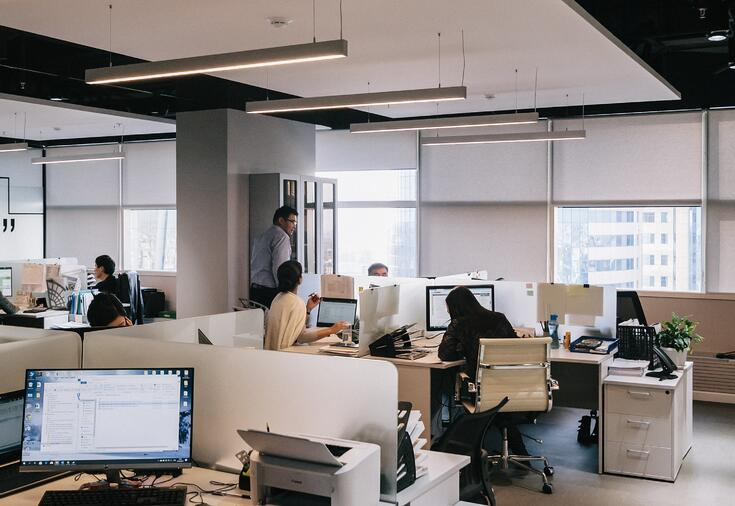 people-working-within-office-space-cubicles