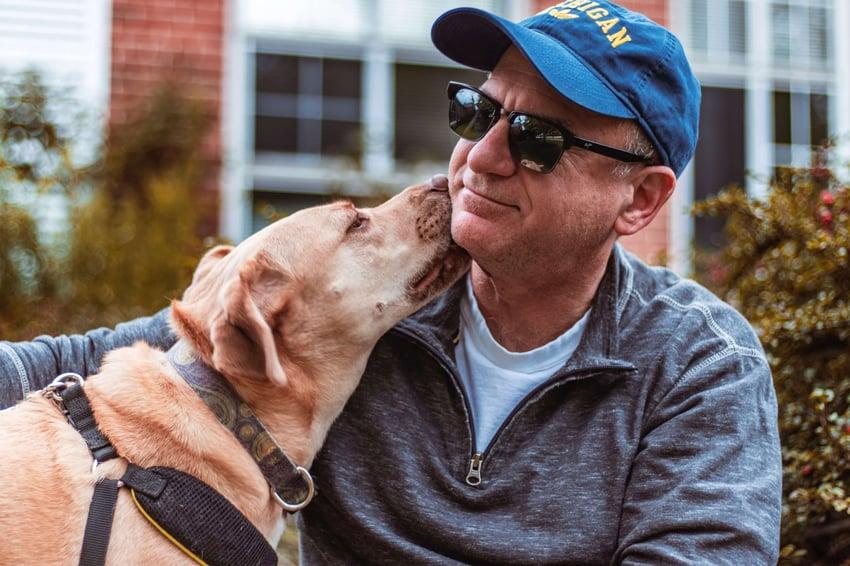 pet-dog-licking-face-of-man