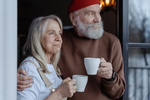 elderly-couple-sipping-coffee