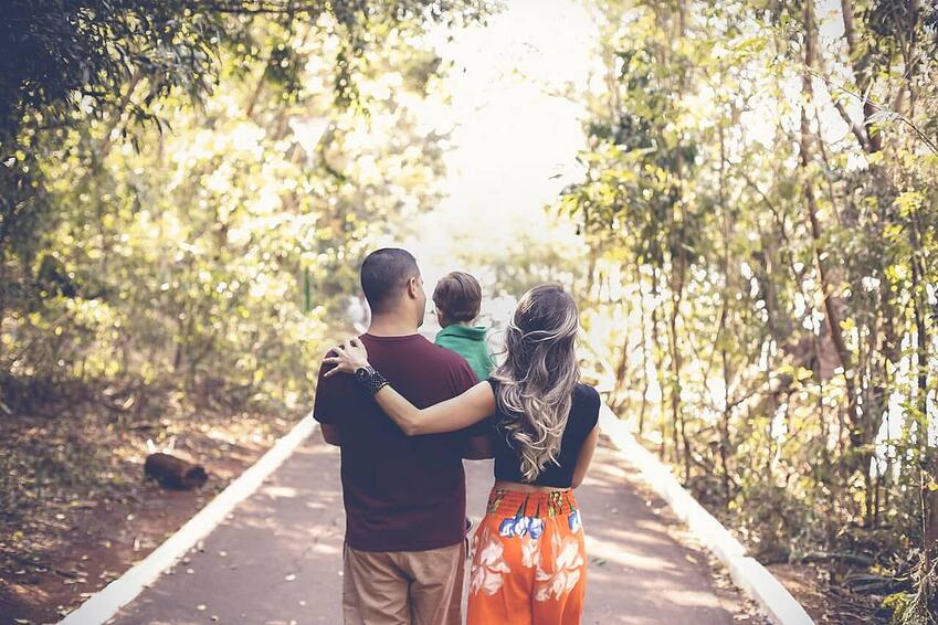 photo-of-family-walking-in-park
