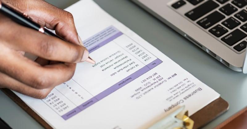 hand-checking-paper-sheet