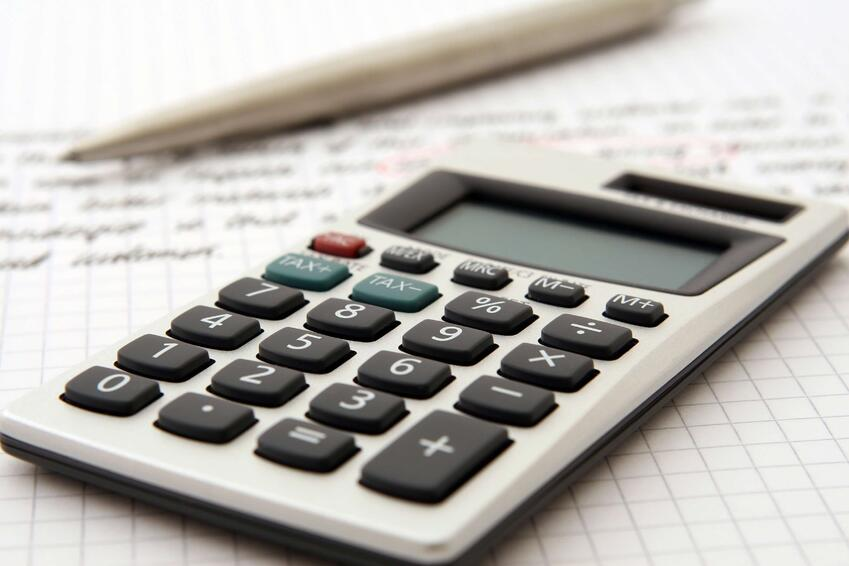 white-and-black-desk-calculator-on-white-graphing-paper